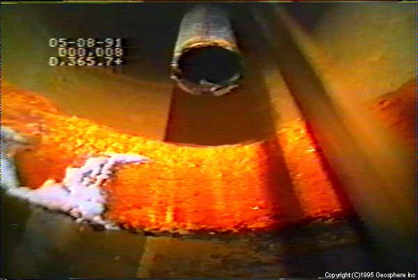 Video still showing casing leakage/corrosion